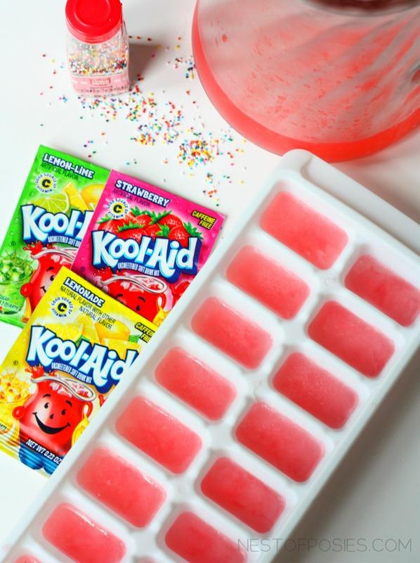 make striped kool aid ice cubes with sprinkles via Nest of Posies