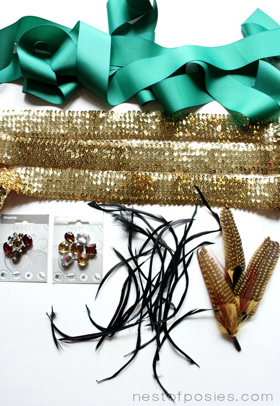 Delicious trim of ribbon & sequins along with feathers to make a Fall wreath via Nest of Posies