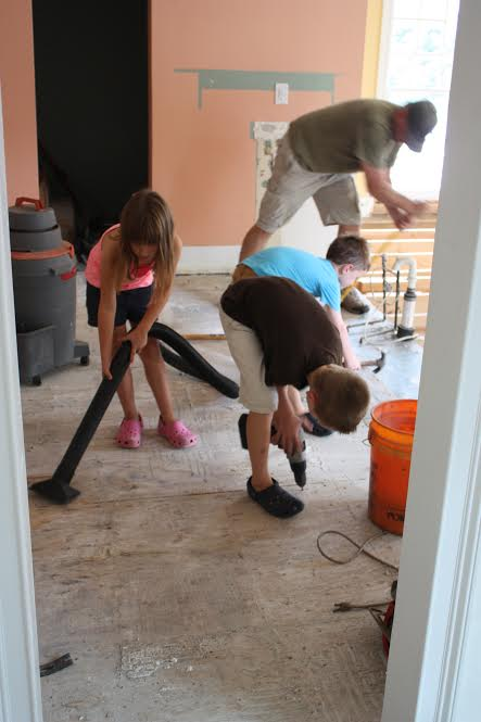 A Family Affair.  Tearing up tile & shop vacuuming.