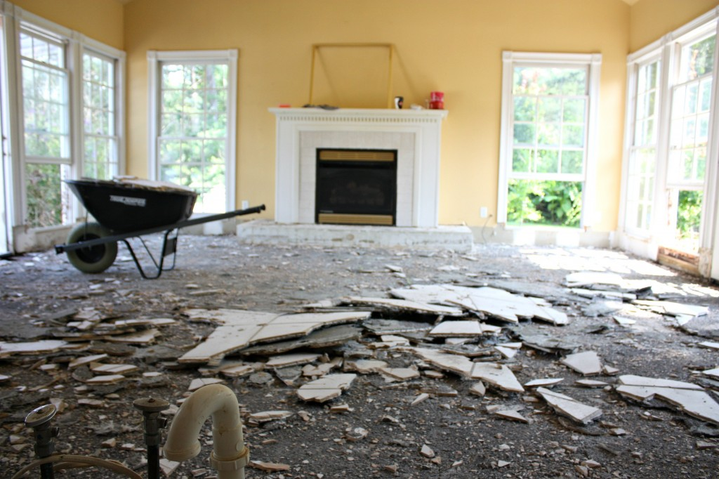Tearing up tile to replace with Hardwood floors