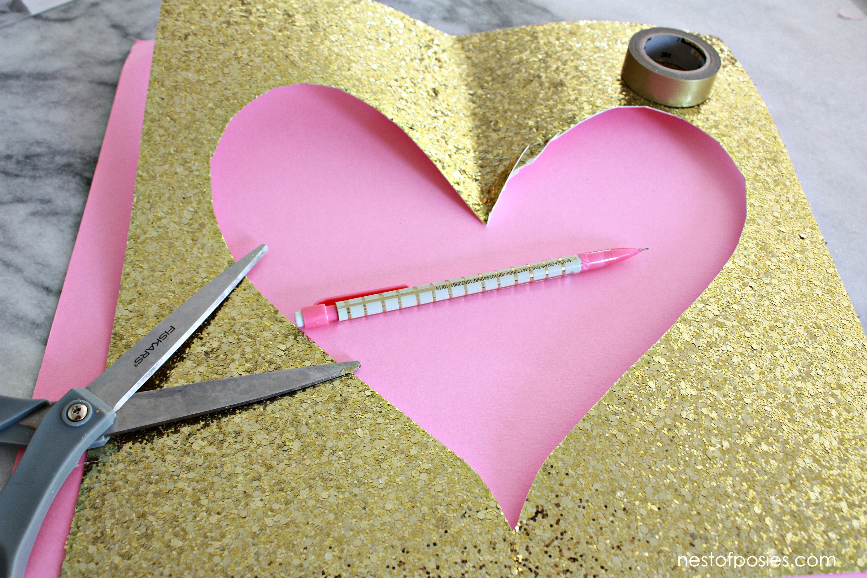 How to scrapbook with glitter paper - Use Glitter Paper To Cut And Layer A Heart For An Added Touch Of Sparkle